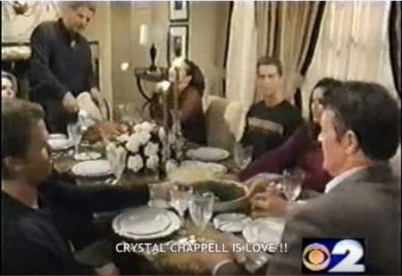 The Lewis family gather around the Thanksgiving table at Olivia's house