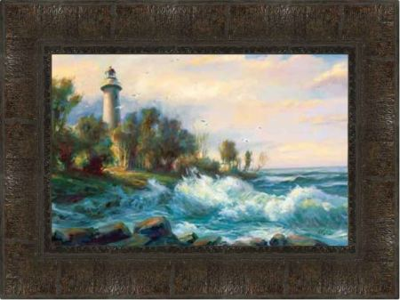 A photo of a framed painting of a lighthouse above a stormy shore