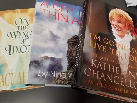 "Three books with book jackets for characters from ""The Young and the Restless"""