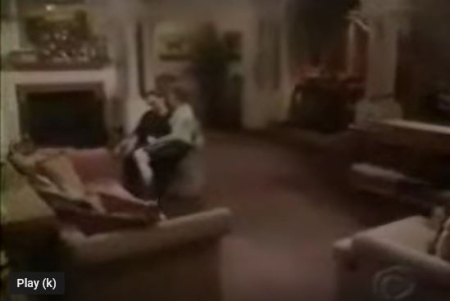 Room with fireplace and Michelle sitting on Danny's lap